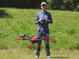 Man flying a quadcopter