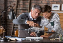 Image of father and son building scale model of DC3