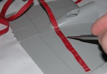 Image of a model maker scribing panel lines on a plastic model plane