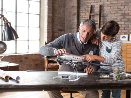 Image of a father and son building a scale model Douglas DC3 airplane, as part of a blog about the top 5 reasons to build scale models with your children.