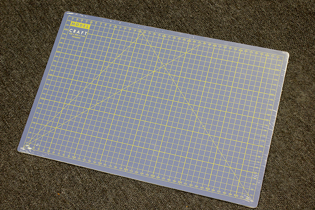 Image of A3 scale modeling mat - part of the Senna McLaren MP4/4 model kit from DeAgostini ModelSpace