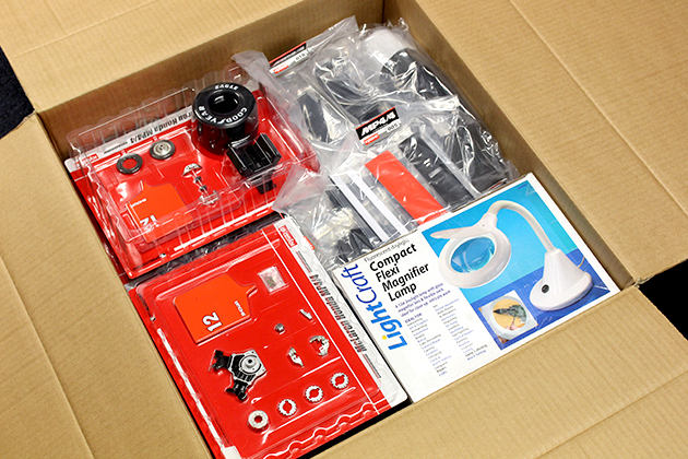 Image of opened box of the full Senna McLaren MP4/4 model kit from DeAgostini ModelSpace