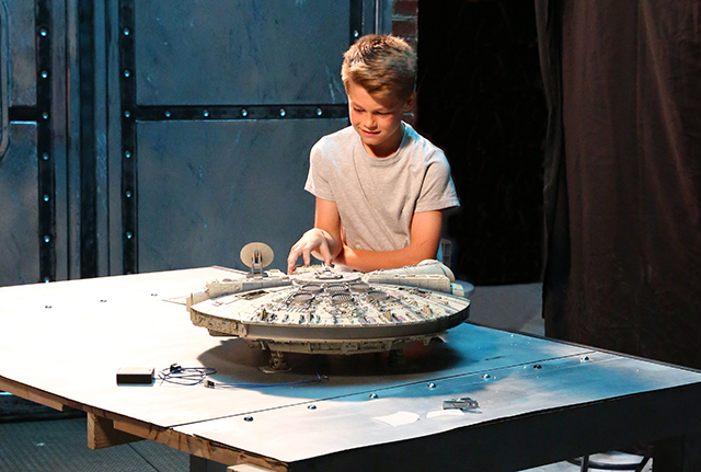 Image of boy with ModelSpace scale model of the Millennium Falcon, as part of a blog about activities to do at home.