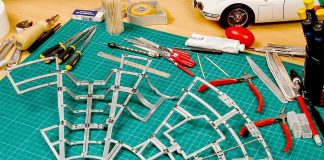 Image of a scale model cutting board with tools and a DeAgostini ModelSpace Millennium Falcon model, as part of a blog about the best Christmas gift ideas for craft lovers
