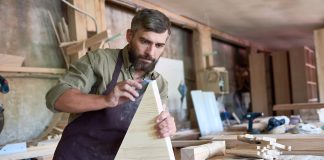 Image of man sanding wood, as the cover image for a blog about abrasives and how to sand scale models.