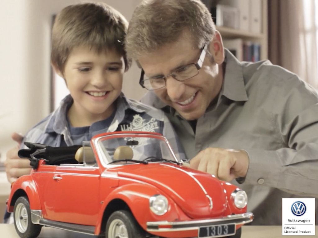 Image of a father and son building a ModelSpace VW Beetle scale model, as part of a blog about activities to do at home.