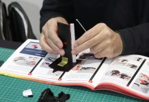 Image of a man building a ModelSpace scale model, as part of a blog about large scale model kits