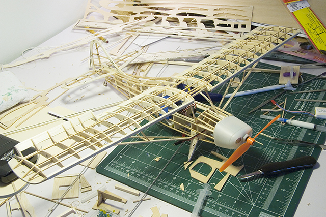 Image of a balsa wood model plane frame, as part of a blog about how to make model planes.
