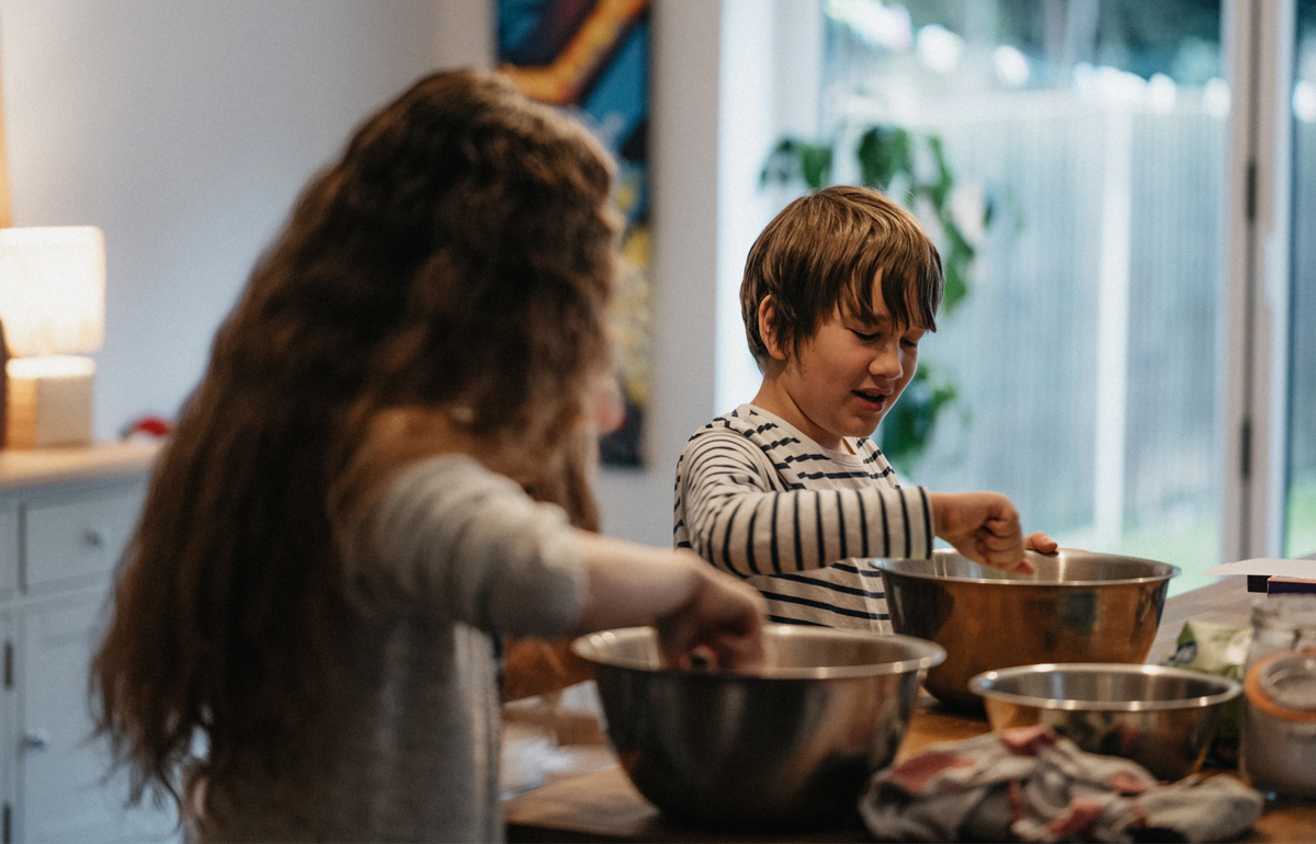 Image of children baking and cooking, as part of a blog about indoor activities for families on rainy days
